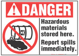 Danger Sign, Hazardous Materials Stored Here. Report Spills Immediately (With Symbol)